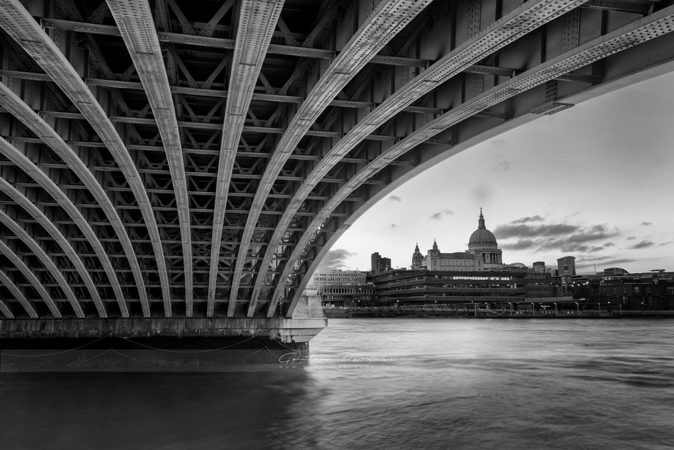 Artistic black and white architecture landscape photo of bridge over Thames river and St Pauls Cathedral in London