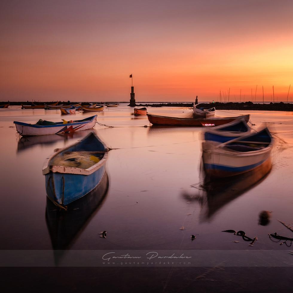 Beautiful landscape photo with sunset colours of a fishing village in Bandra Mumbai