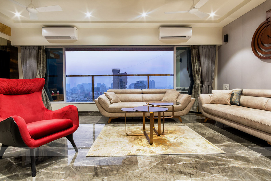Interior photo of a living room in Borivali with a red couch