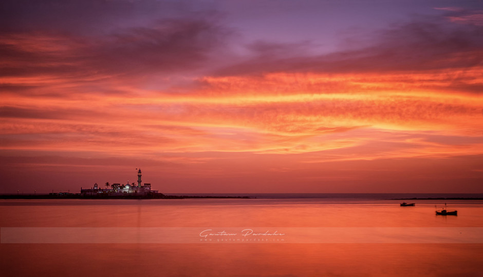 Beautiful landscape image with vibrant sunset colours at Haji ali in Mumbai [Bombay]