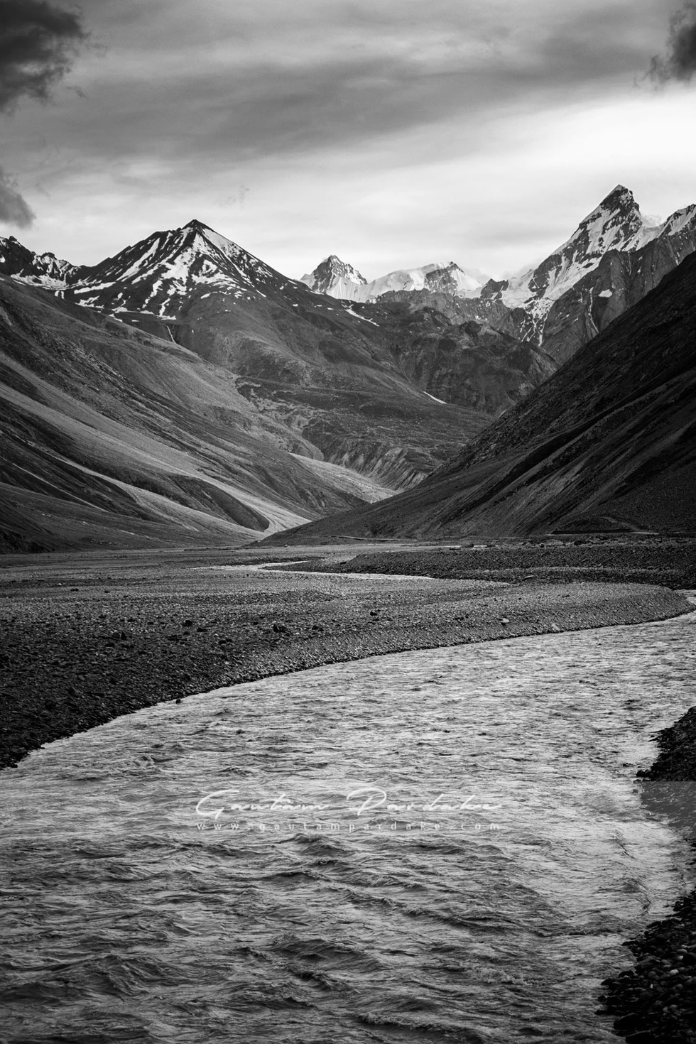 Artistic black and white image of a stream running in the high Himlayan mountains of Spiti, India