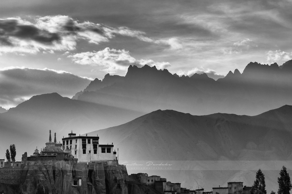 Artistic black and white landscape photo of a monastery in the high Himlayan mountains of Ladakh India