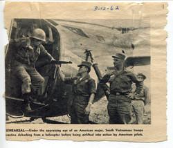 Major Gainok on left, observing.