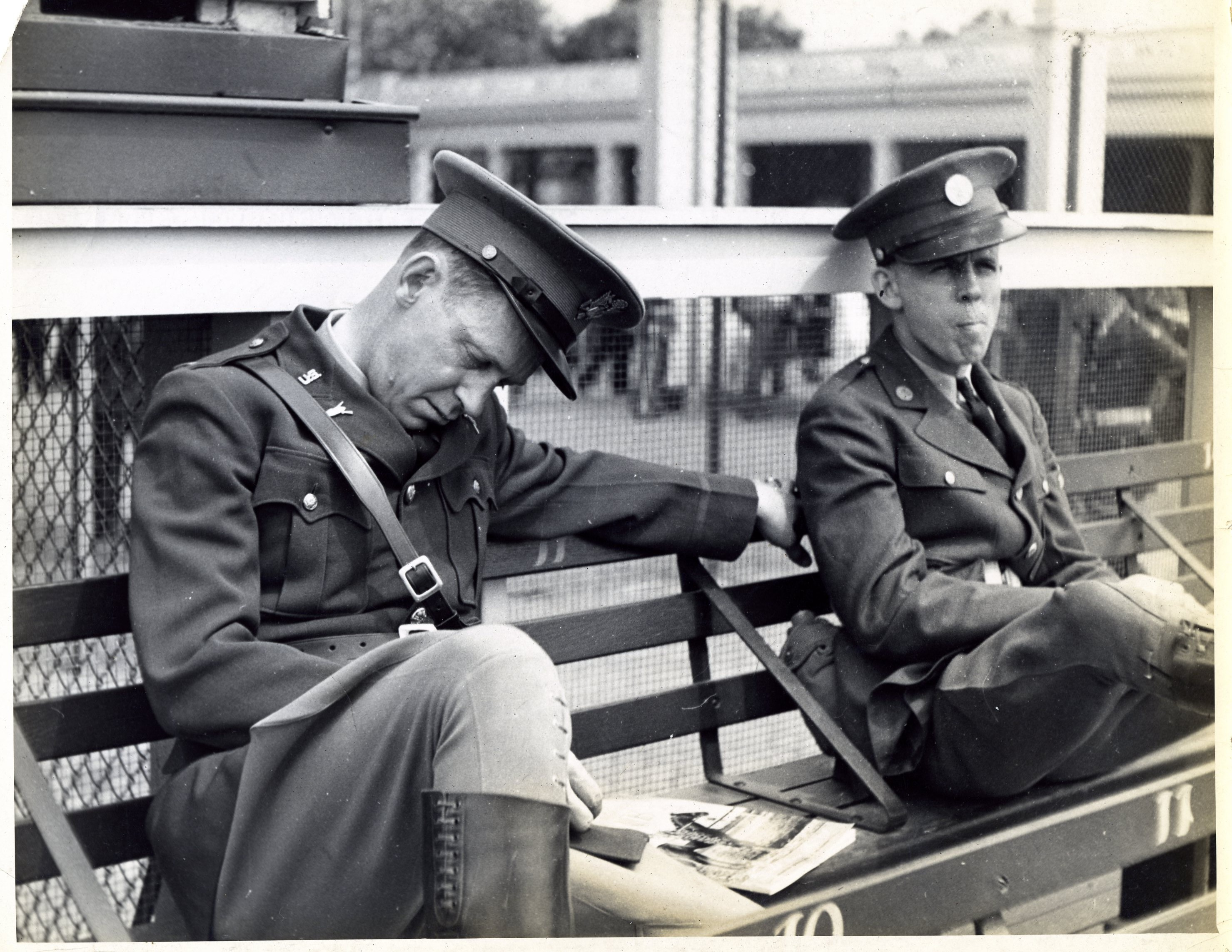 Ky Derby. Lt Truman Mayes asleep,  Edwin Elliott, eating peanuts at 8 a.m. Waiting for crowd, Co. D,