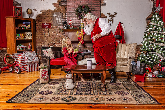 Santa and girl painting toys