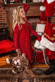 Girl holding Santa's hand