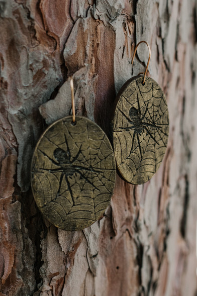 Oval shaped web and spider earrings