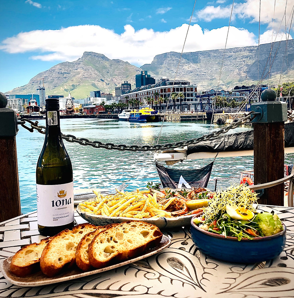 Ginja restaurant at Victoria and Alfred hotel, Cape Town South Africa. Summer Prawn special. R550.00 for Prawn platter for 2 including bottle of Iona wine. Summer special, seafood special. celebrate V&A birthday. Ginja restaurant on waterfront, boats and Table Mountain ciew.