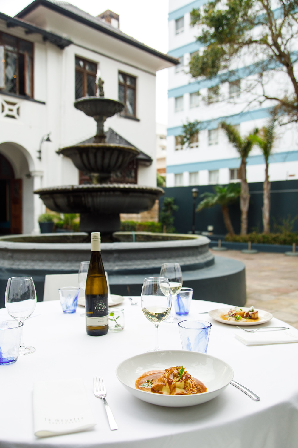 Lunch set up in the beautiful court yard a La Mouette restaurant in cape Town, South Africa. Wine and lunch pairing.