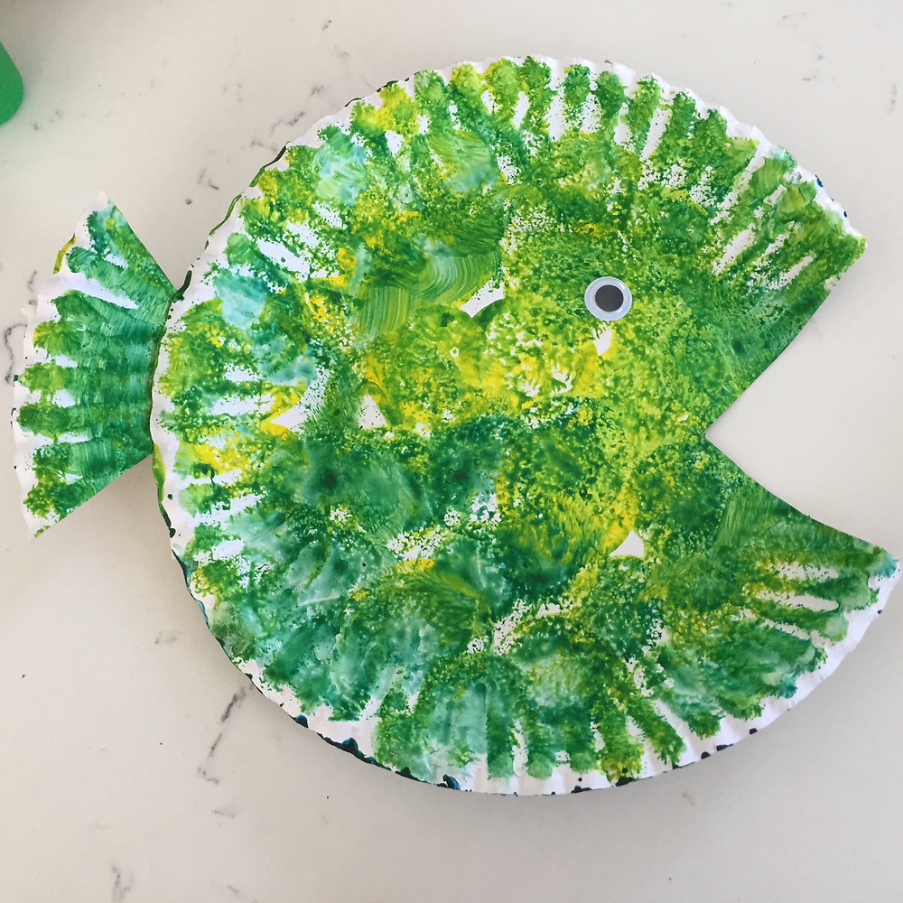 Stick the tail on the fish using glue and scotch tape. Stick they eye on the fish for this DIY fish decor project