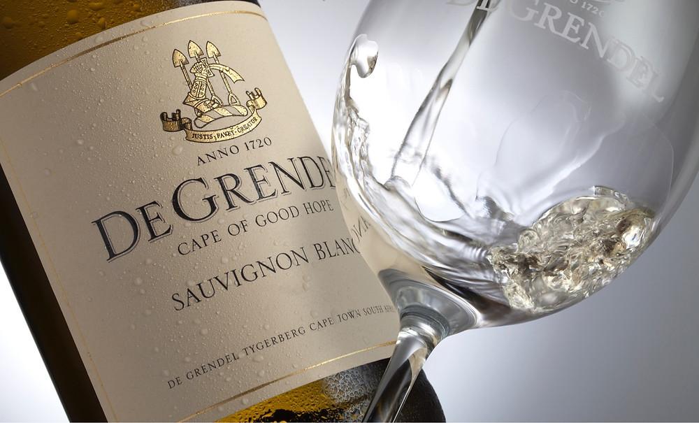 De Grendel Sauvignon Blanc. White wine being poured into glass.