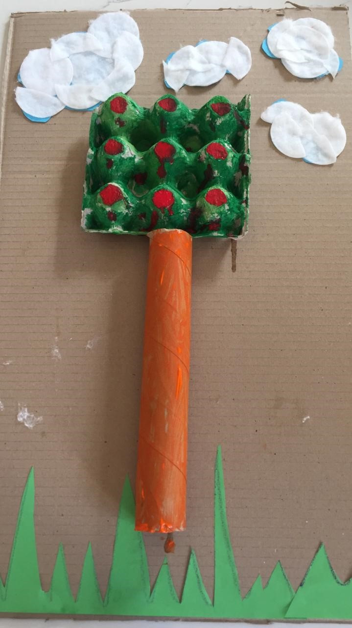 Finished product of easy DIY tree craft for child to do with recycled materials