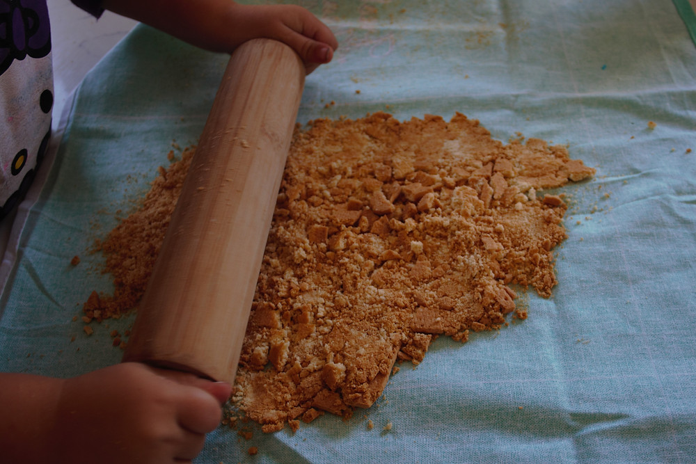 Tennis Biscuits being crushed to form the base of the puddings