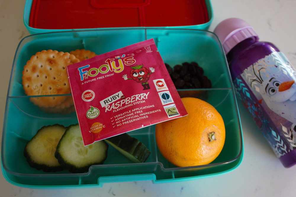 Footys raspberry juice sachette was chosen to eb packed into lunch box.