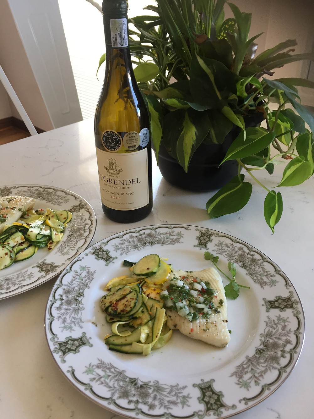 Wine pairing. De Grendel Sauvignon Blanc paired with Calamari Steak and Baby Marrow salad.