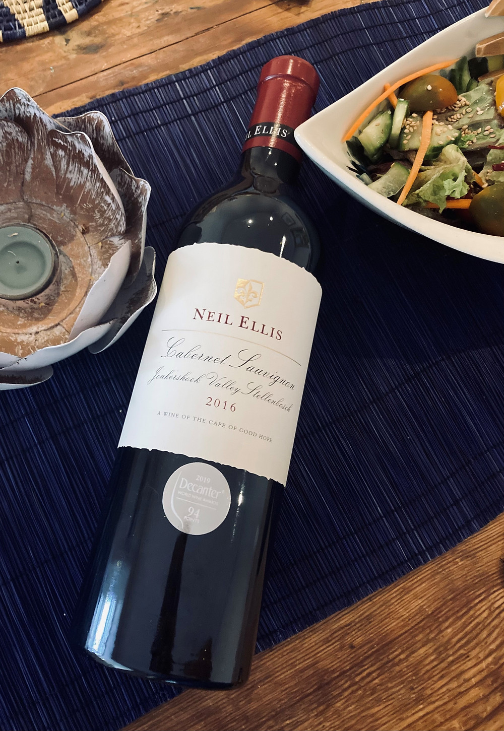 Neil Ellis Jonkershoek Velley Cabernet sauvignon blanc wine n dinner table