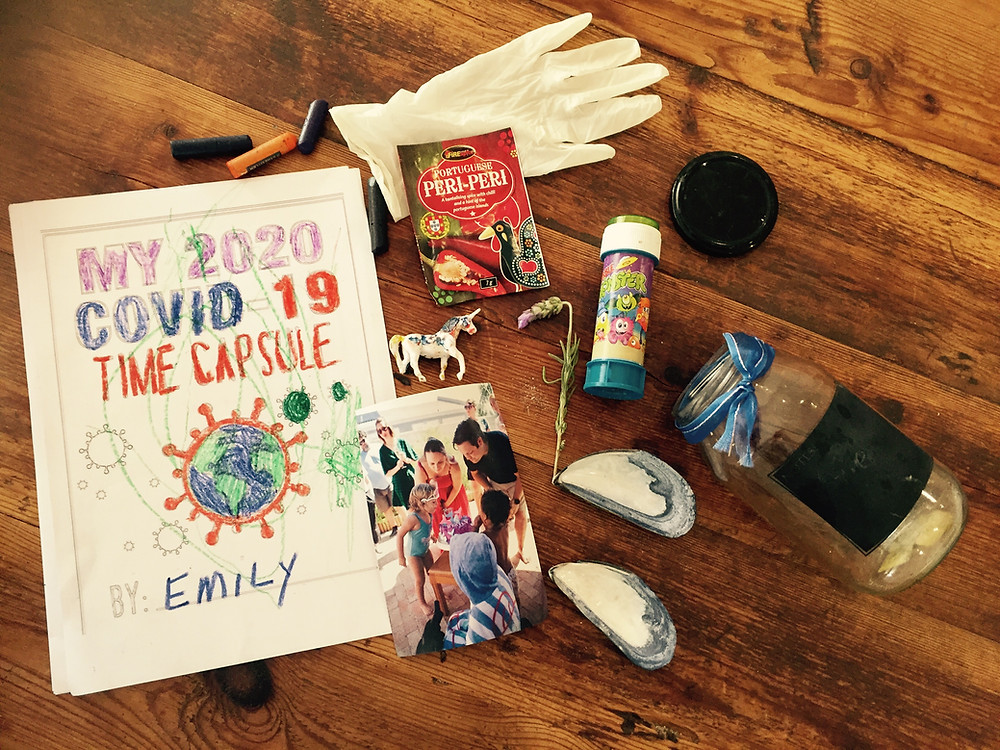 What we put into our Covid-19 time capsule to remember the pandemic. Placed items of meaning, family photo and item to represent each family memeber.