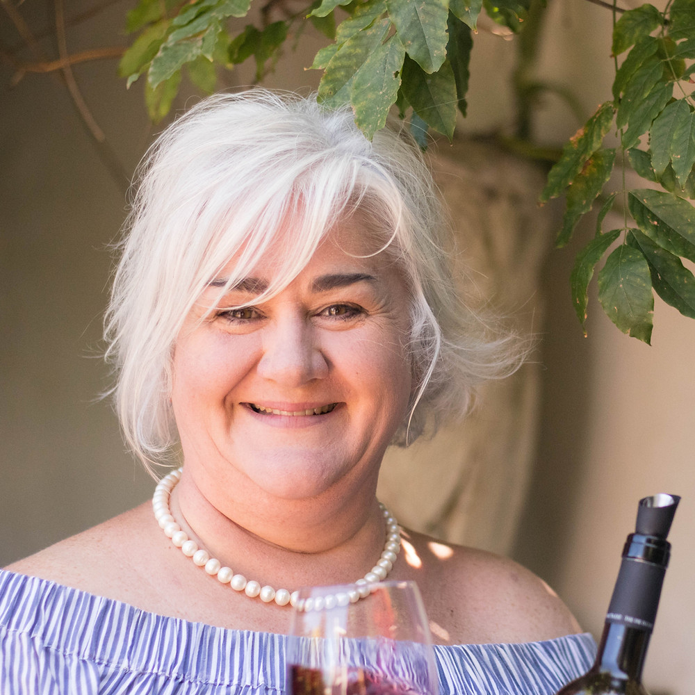Katie Barratt is also known as the Wine Fairy. Runs wine tours and educational wine seminars