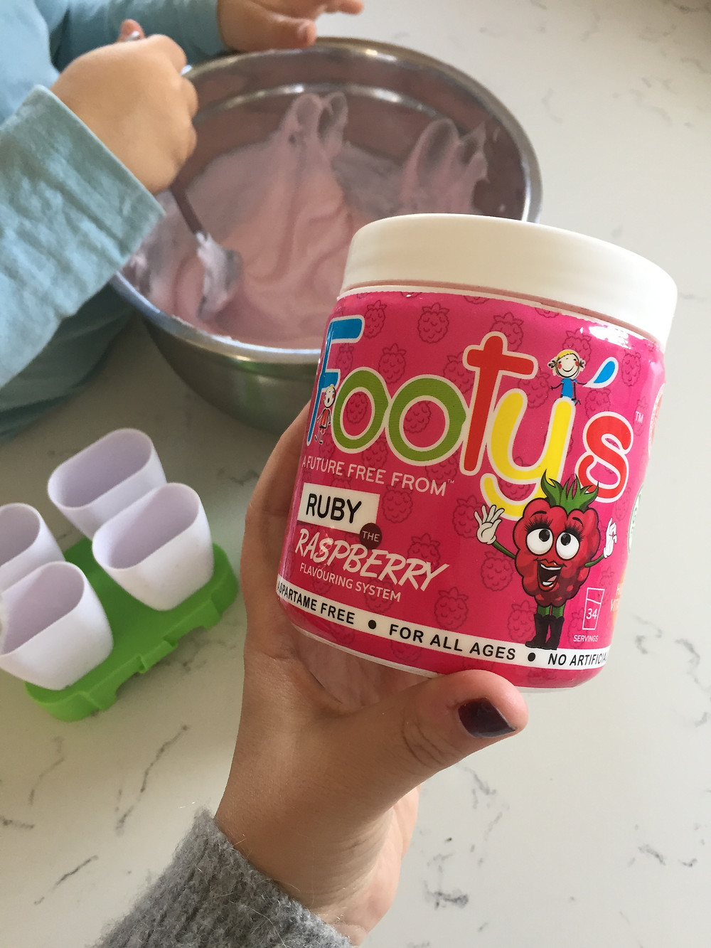 Footy's Raspberry flavoring added to yogurt for icelollies. Children cooking