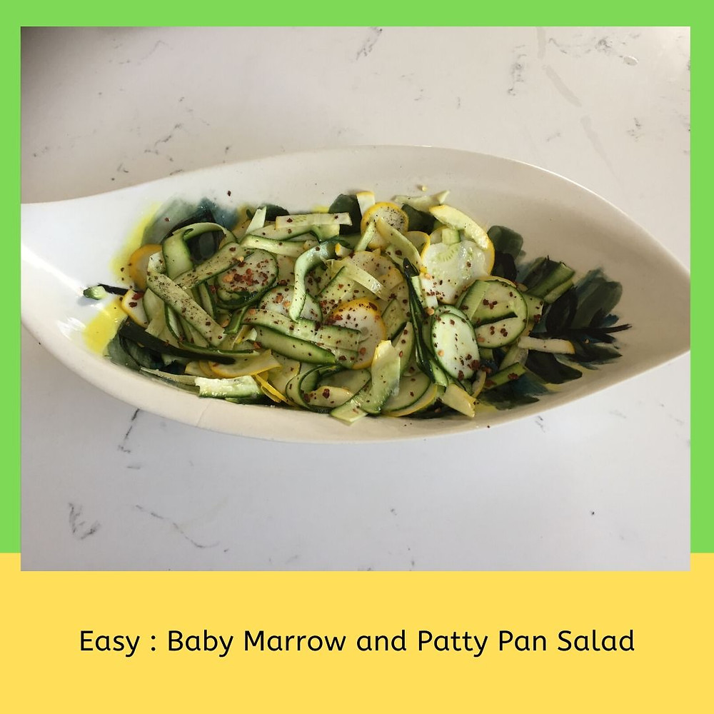 Zucchini summer salad. Thinly Sliced Zucchini and Patty Pan Squash salad in lemon juice , served with chilli flakes.