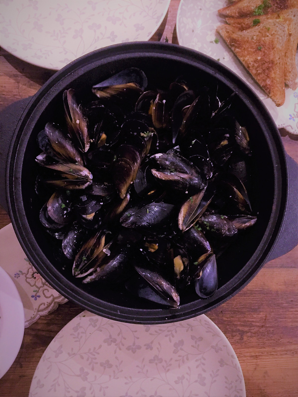 Mussel pot ready to be eaten. Mussels open and ready to eat