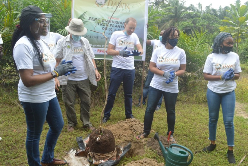 Collaborators and Volunteers planting a Jacaranda Tree at Lufasi Park
