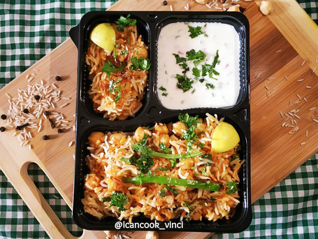 Chole Dum Biryani with smoked Vegetable Raita