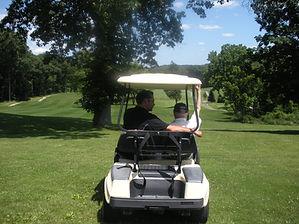 teddy and greg in cart.JPG