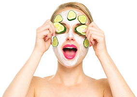 Funny smiling Spa Woman applying fresh Facial Mask with cucumbers. Beauty Treatments. Face mask, ski