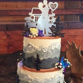 Jeep and mountain wedding cake made by the cake artists at Button Rock Bakery.