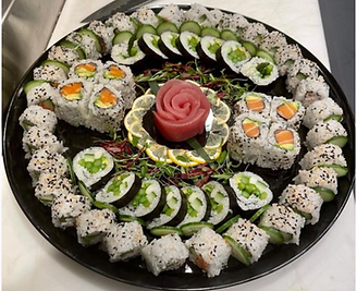 Sushi platter with a variety of rolls regular and gluten free.
