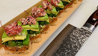 Sushi made by on site sushi chefs with fresh ingredients including avocado, asparagus, salmon