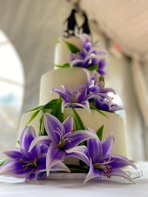 Purple floral cake with penguins