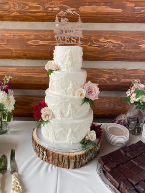 Beautiful wedding cake with nature log plate