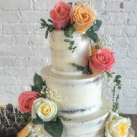Gorgeous fresh rose wedding cake with light frosting.