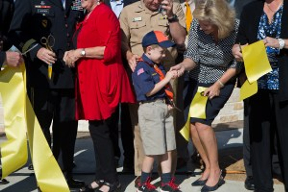 NTC President and CEO Mabrie Jackson with a little hero