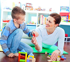 mother-son-playing-on-floor.jpg