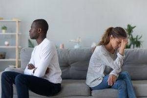 bigstock-Multiethnic-Couple-Sit-Separat-