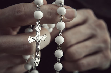 Canva - Woman  with rosary.jpg
