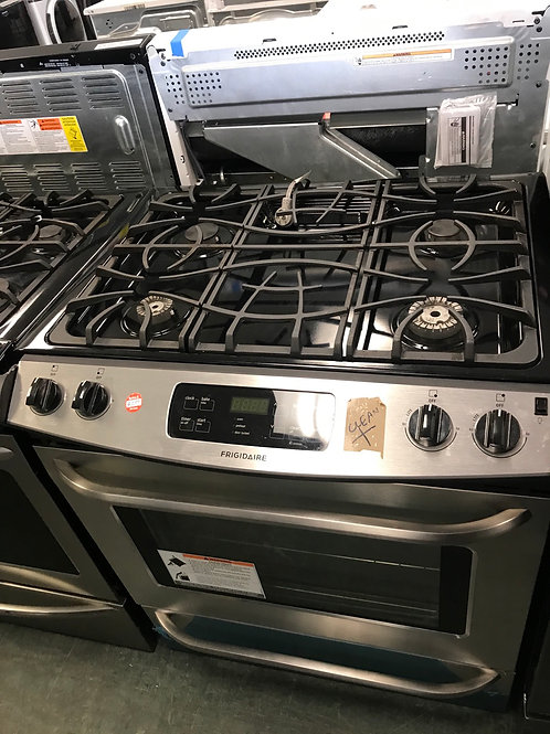 Frigidaire return model stainless steel gas slide in range in working condition.