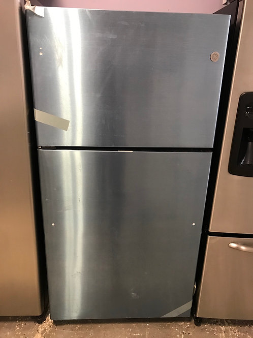 "Ge new 33"" open box stainless steel top and bottom fridge."