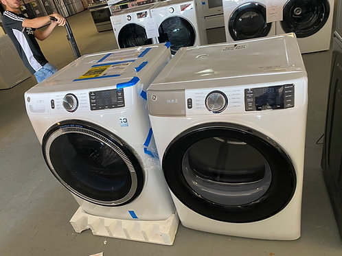 Ge new ultra fresh vent Stackable washer dryer set.