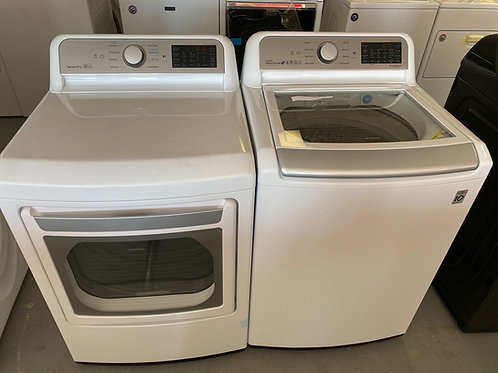 LG new top load washer dryer set with 1 year warranty.