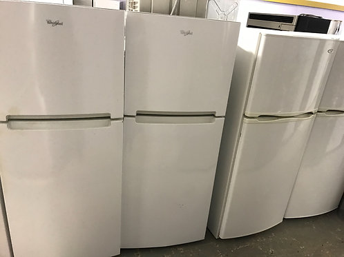 Whirlpool brand refurbished top bottom fridge works great.
