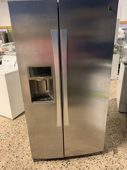 Kenmore brand refurbished stainless steel side by side refrigerator.