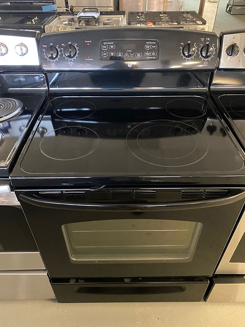 Ge black electric glass top stove with warranty.