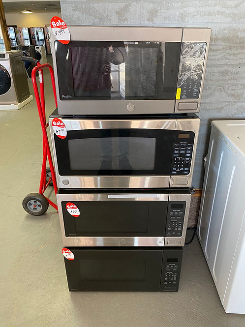 NEW GE COUNTER MICROWAVES STAINLESS AND BLACK WITH WARRANTY