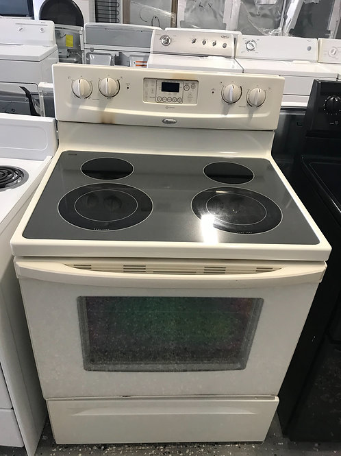 Whirlpool brand refurbished almond glass top stove with warranty.