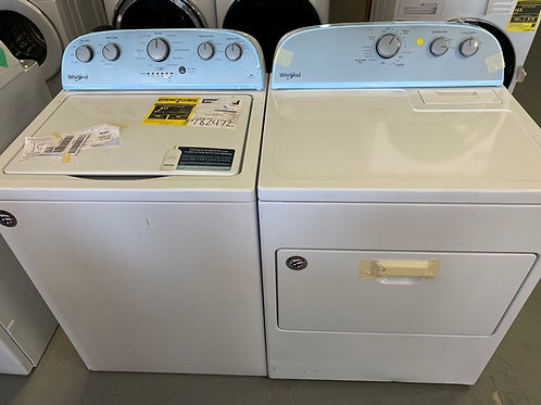 Whirlpool new scratch and dent top load washer dryer set with 1 year warranty.