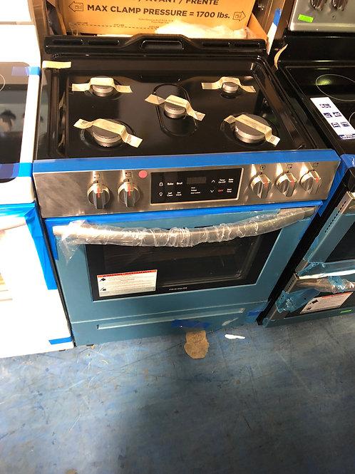 Brand new Frigidaire stainless slide in gas stove with 1 year warranty